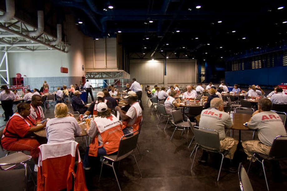 HEB's 45-foot mobile kitchen was parked in a loading dock on the third floor of the George R. Brown Convention center and HEB employees served burgers to dozens of first responders and disaster recovery teams from across the country. Photo: R. Clayton McKee, For The Chronicle