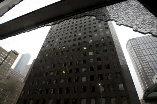 Damage to JP Morgan Chase Tower is seen from a building across Travis. Photo: James Nielsen, Chronicle