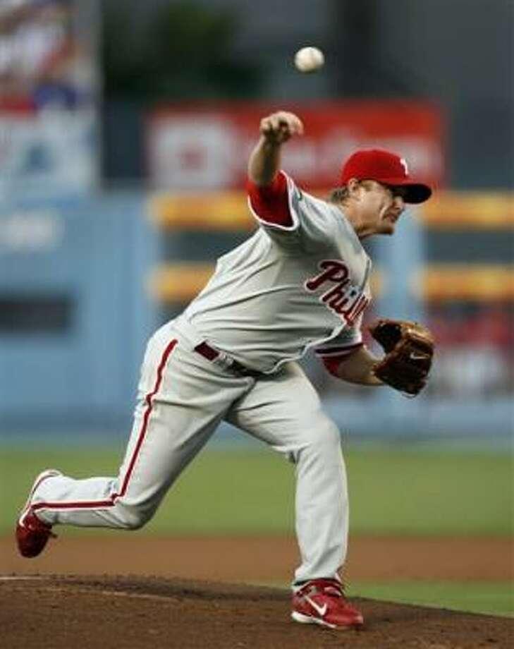 Pitcher J.D. Durbin got the win and had three of Philadelphia's 26 hits. Photo: Mark Avery, AP