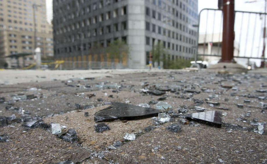 Glass debris from Chase Tower still litters some of downtown's streets. Photo: James Nielsen, Chronicle