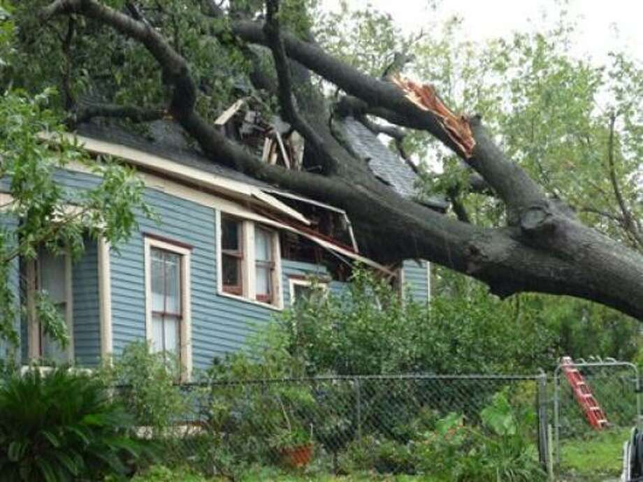 House in the Heights crushed by falling tree Photo: Bgscott, Chron.commons