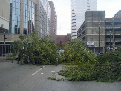 Downed trees block Prairie near Milam in downtown Houston. Photo: Luis Perez, Chronicle