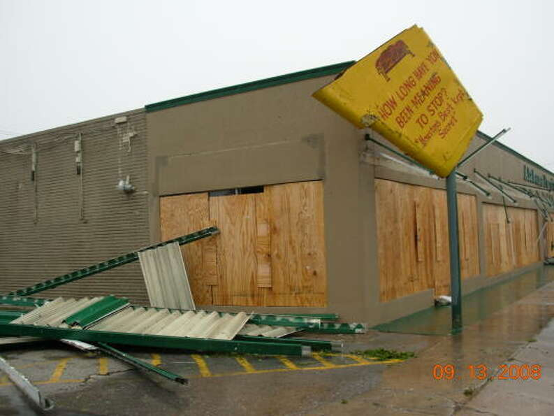 Winds from Hurricane Ike damaged Alabama Furniture at Yale Street and 22nd Street in Houston.