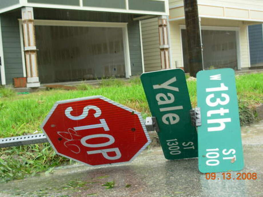Winds toppled this street sign at the intersection of Yale Street and 13th Street. Photo: Jim Newkirk, Chronicle