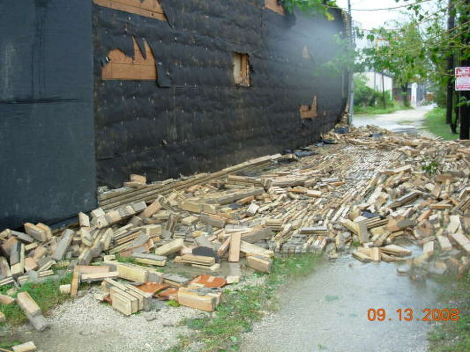 Winds tore bricks off of this structure along Washington Avenue in Houston. Photo: Jim Newkirk, Chronicle
