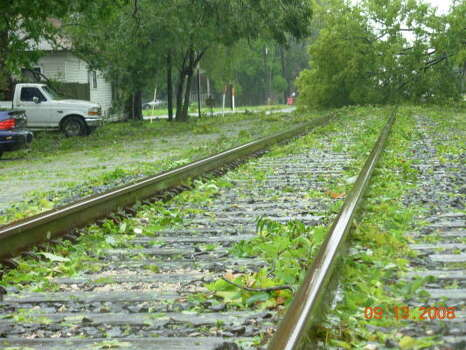 Winds from Hurricane Ike downed this tree over railroad tracks near Houston Avenue and Winter Street. Photo: Jim Newkirk, Chronicle