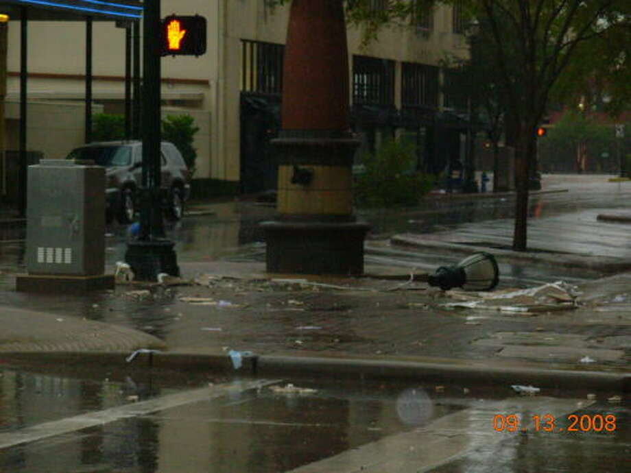 Winds damaged a lamp post in downtown Houston. Photo: Chronicle