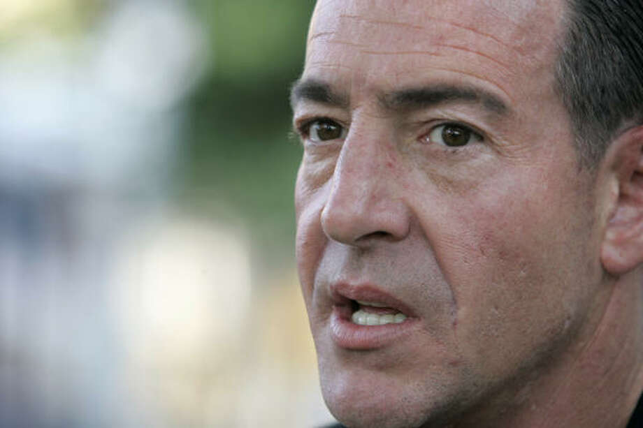 """Michael Lohan, shown speaking at a Long Island Teen Challenge event July 25, told a judge Friday that he worked """"for Teen Challenge. I work for God."""" Photo: Frank Franklin II, AP"""