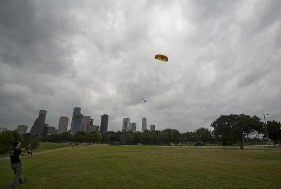 Remi Loiseau takes advantage of gusting winds as the early stages of Hurricane Ike reach Houston Friday. His kite at times lifted him briefly from the ground. Photo: Steve Ueckert, Chronicle