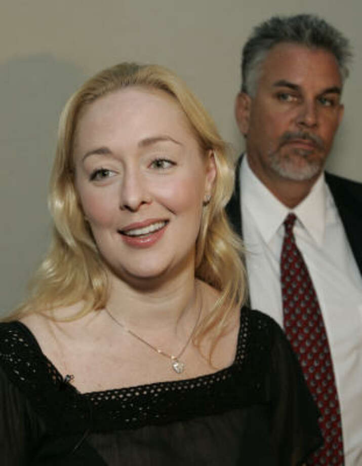 Mindy McCready, left, answers questions following a court date in August, 2006. Photo: JOHN RUSSELL, AP