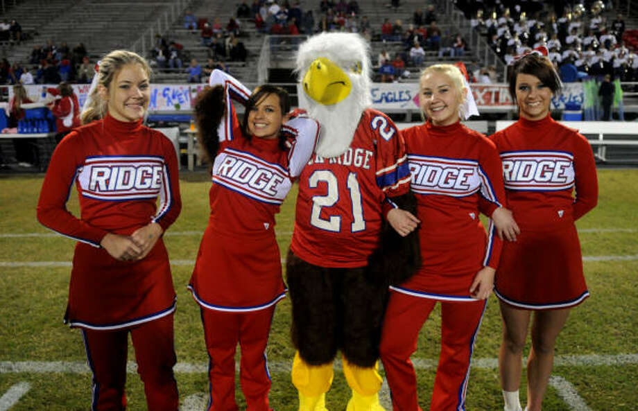 Members of the Oak Ridge High School Good Sportsmanship League, including varsity cheerleader Emily Henderson, left, Candice Cavin, mascot Natalie Howard, Kelbye Gaskill and Neely Fletcher, wait to make their walk to midfield to meet the New Caney High School GSL members on Oct. 24. Photo: Jerry Baker, For The Chronicle