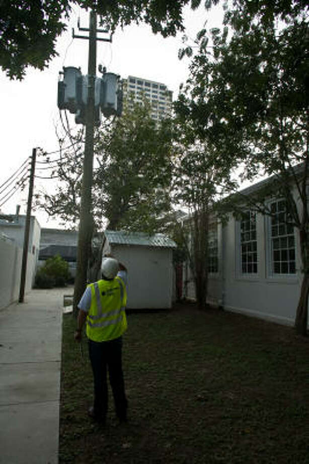 A Centerpoint Energy technician checks the electrical lines at River Oaks Elementary School, which remained closed Sept. 25 due to damage from Hurricane Ike. Photo: R. Clayton McKee, For The Chronicle