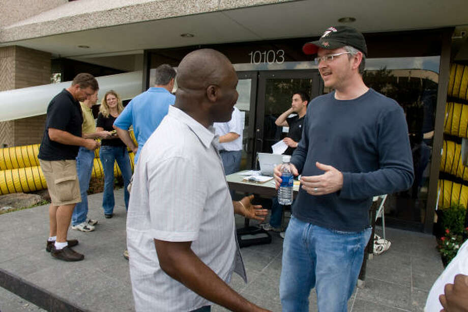 Doug Duerr, building manager, talks to tenant Kenneth Chukwunenye, of Prime Home Health Care, at Brays Oaks Towers, 10103 Fondren, which remains without power after Hurricane Ike. Photo: R. Clayton McKee, For The Chronicle