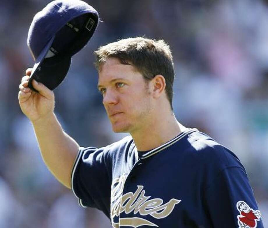 The Padres' Jake Peavy acknowledges the ovation he received upon leaving the game after allowing one run in 7 1/3  innings. Photo: DENIS POROY, ASSOCIATED PRESS