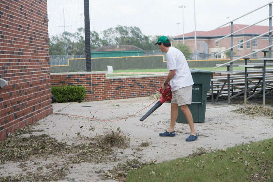 West University Little League board member Stephen Crain helps clean up the ballpark as residents of West University Place go about setting their lives and their city back in order after Hurricane Ike. Photo: R. Clayton McKee, For The Chronicle