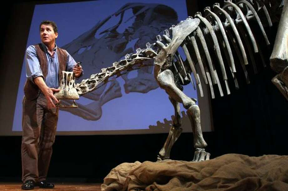 Paleontologist Paul Sereno unveils a new, elephant-sized dinosaur named Nigersaurus taqueti. The dinosaur is thought to dispel myths of all long-necked species eating from trees. Photo: LAUREN VICTORIA BURKE, ASSOCIATED PRESS