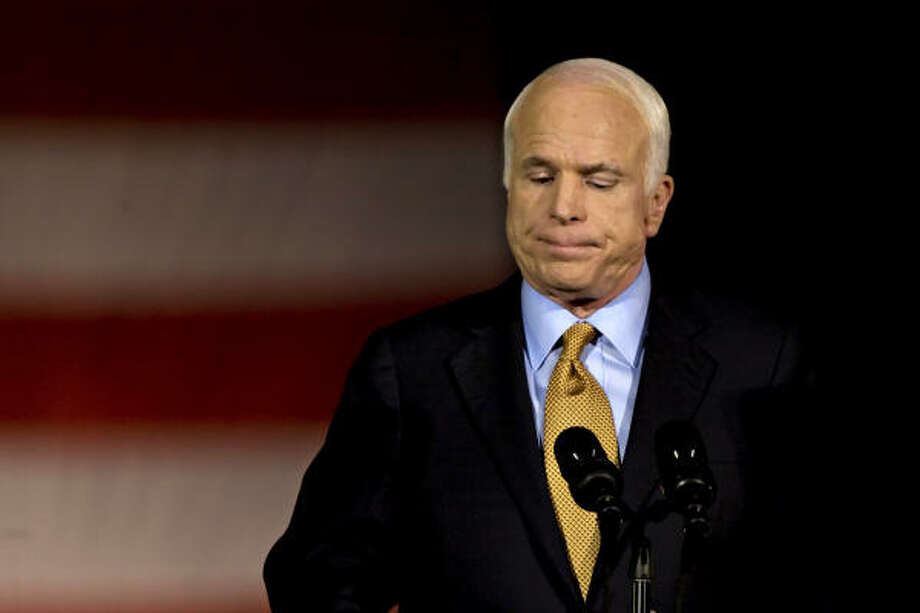 John McCain pauses while delivering his concession speech in Phoenix. Photo: ANDREW HARRER, BLOOMBERG NEWS