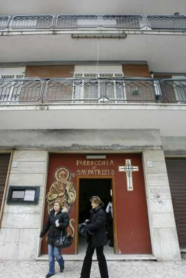 This church in San Patrizio Parish in Rome's Colle della Mentuccia neighborhood was meant to be temporary. After more than 30 years here, its pastor will inaugurate a new church building on Sunday. Photo: ALESSANDRA TARANTINO, ASSOCIATED PRESS