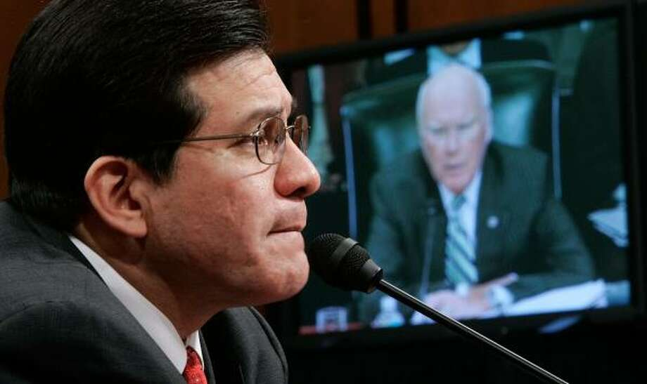 Alberto Gonzales is questioned by Sen. Patrick Leahy, D-Vt., seen on a TV monitor, during Thursday's hearing. Photo: ALEX WONG, GETTY IMAGES
