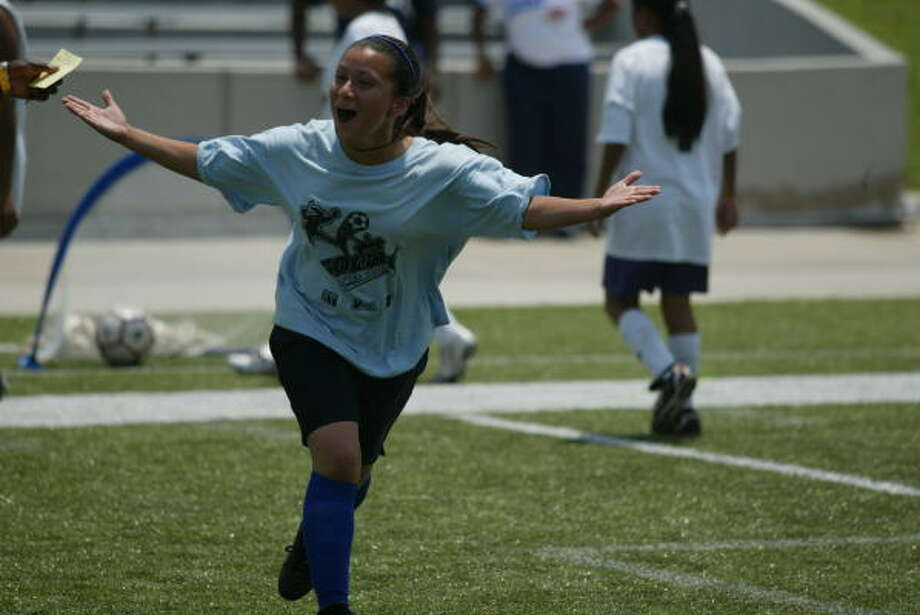 Jane Long Middle School's Elizabeth Mendoza celebrates her goal at Delmar Stadium during the inaugural Copa Soccer After School 4x4 soccer tournament. Photo: Matthew White, For The Chronicle