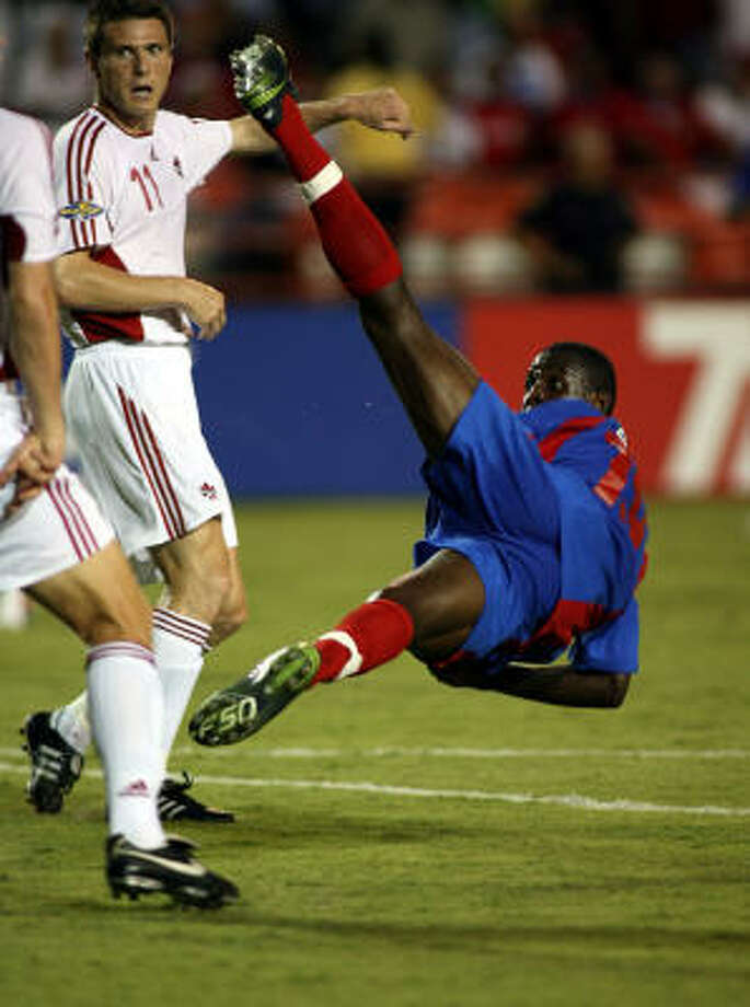 In Miami, Richard Hastings and Canada (in white) beat Ricardo Pierre-Louis and Haiti 2-0 on Monday in the Gold Cup. Photo: Marc Serota, Getty Images