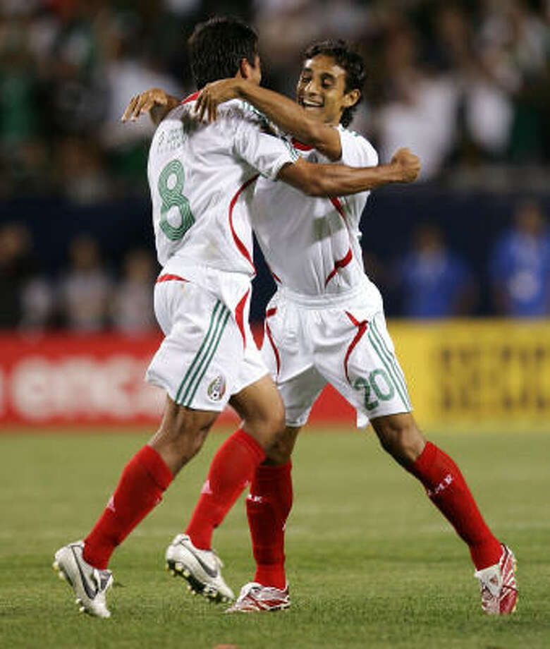 Pavel Pardo, left, and Fernando Arce celebrate  Pardo's goal that gave Mexico the victory. Photo: Jonathan Daniel, Getty Images