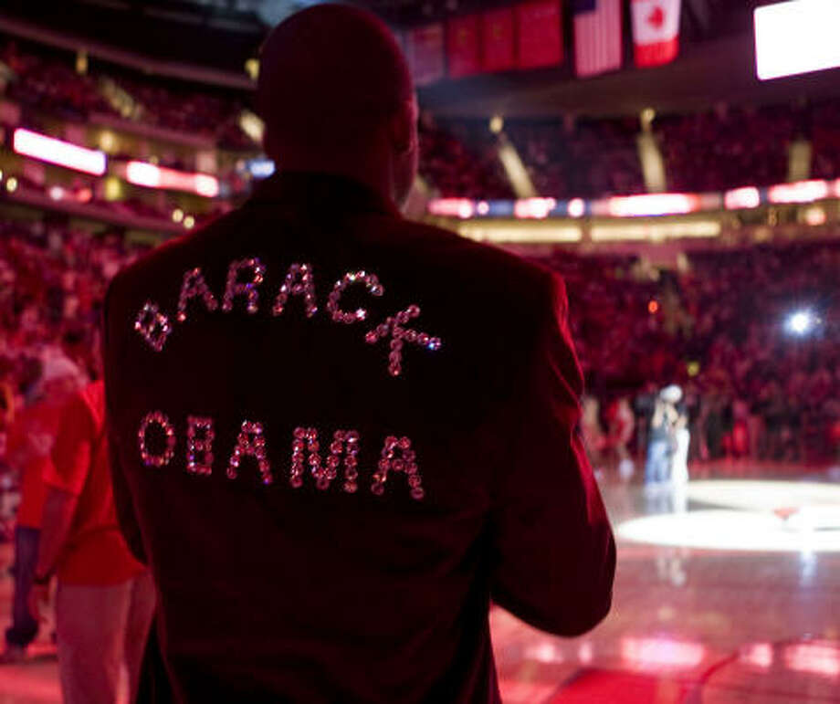 The Houston Rockets Steve Francis wears a jacket supporting democratic presidential candidate Barack Obama during player introductions before the Rockets play the Boston Celtics. Photo: James Nielsen, Chronicle