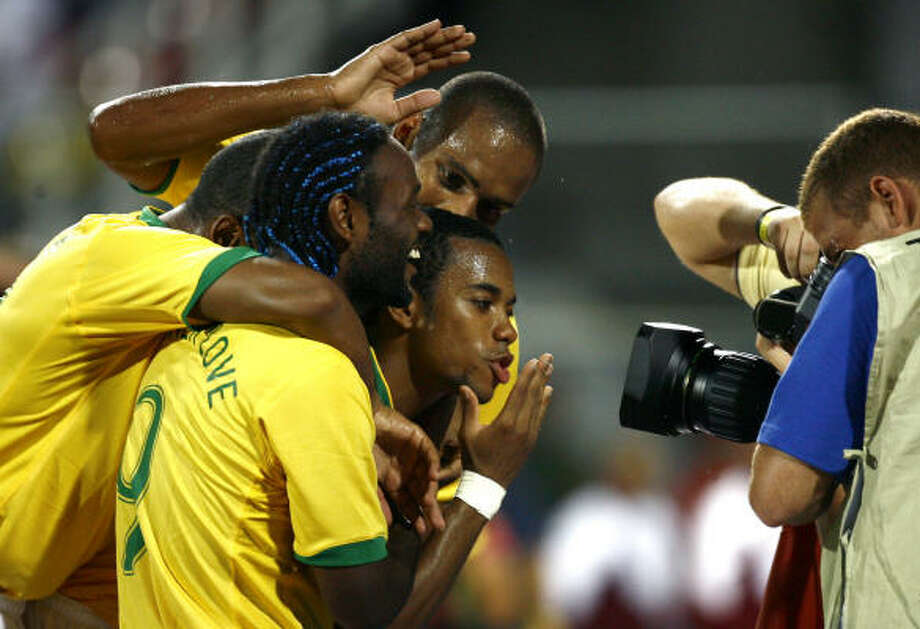 Brazil's Robinho mugs in front of a television camera after scoring one of his two goals on Saturday. Photo: Claudio Cruz, AP