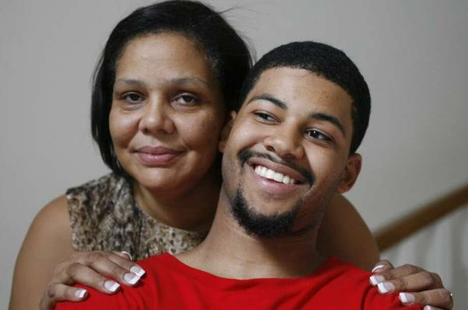 Brandon Williams, with mom Cathy Williams, was a star athlete at Texas Christian School before being expelled. Photo: BILLY SMITH II, CHRONICLE