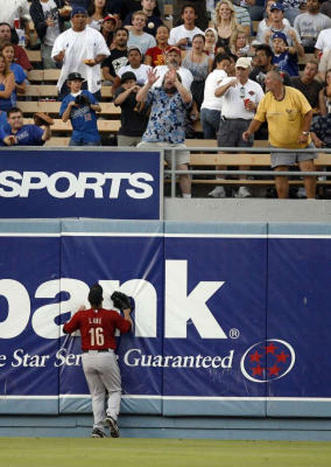 Jason Lane watches Matt Kemp's hit reach the seats in the first. Photo: Mark Avery, AP