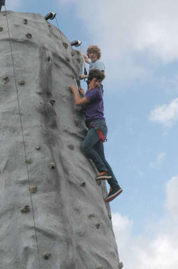 Axel Scharning and James Elmore, both 15, test the rock wall during the Houston Park and Recreation Department and Houston Park Board marks the official accuistion of land to construct Hackbery Park in Alief. Photo: George Wong, For The Chronicle