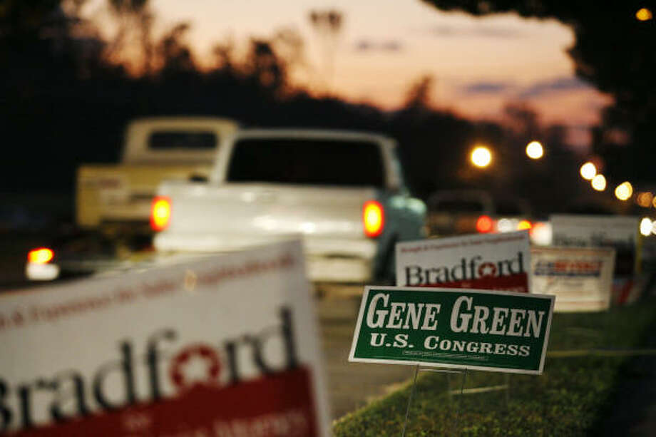 Houston campaign signs line the road Nov. 4 in front of the Acres Homes Multi-Service Center. Photo: Eric Kayne, Chronicle