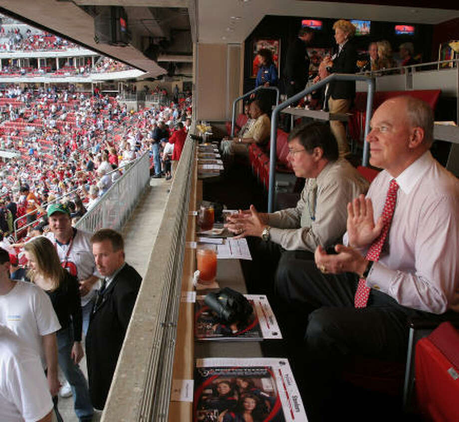 Bob McNair (right) would like more to clap about. Photo: RICHARD CARSON, For The Chronicle