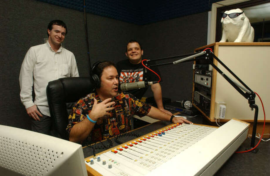 Mark Moss, center, helps students Brandon Webb and Brad Denison at Alvin Community College's radio station. Photo: Jimmy Loyd, For The Chronicle
