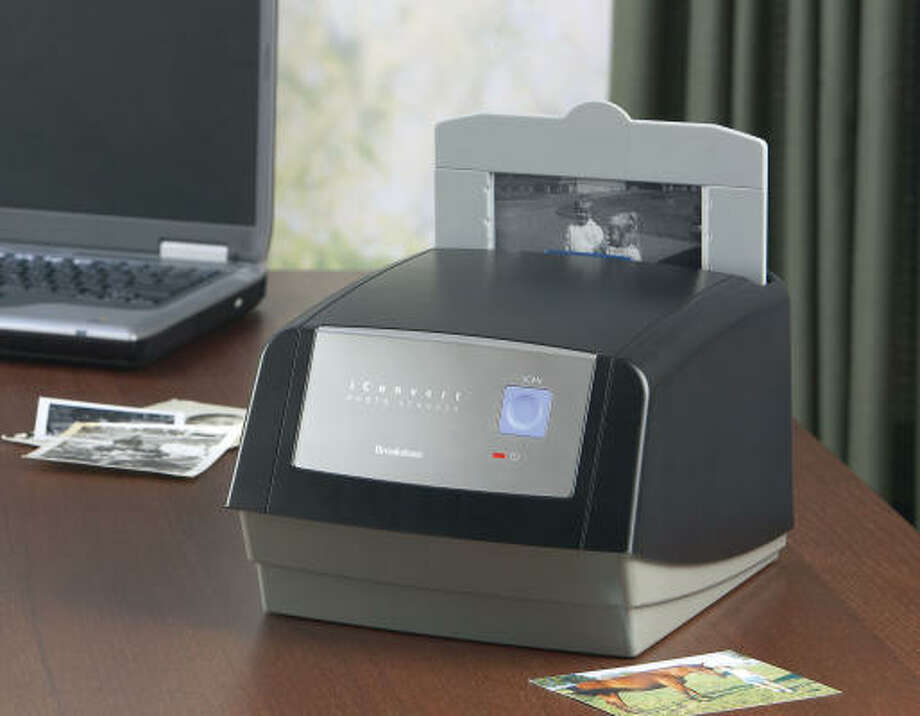 For Tech Wizard:iConvert Photo Scanner (converts photos into JPEGs), $149.95, Brookstone Photo: Kevin Rose