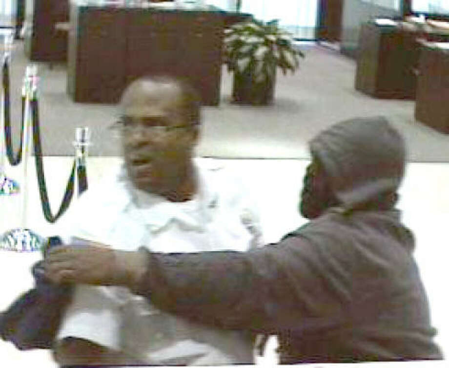 Surveillance photo of suspect with security guard at Whitney Bank robbery on Main in January. Photo: Houston Police Department