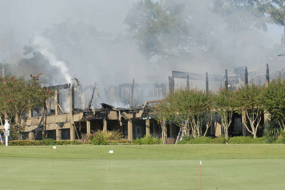There's not much left to the main club house of the April Sound Country Club after a fire early Friday. Photo: Craig Prejean, For The Chronicle