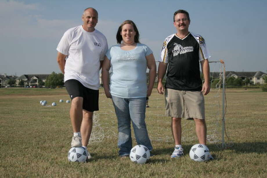 John Moore, Kitty Smith and Tony Hubble are leading a soccer league for disabled children at CrossPoint Church every Saturday in October. Photo: Kenzie DelaTorre, For The Chronicle
