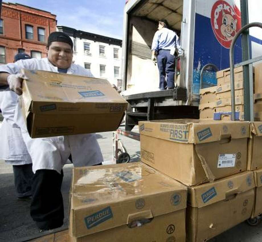 Boxes of chicken are delivered to a New York supermarket. The cost of food spiked when demand for ethanol drove up the cost of grain, but not as much as it likely will, economists warn. Photo: MARK LENNIHAN, ASSOCIATED PRESS FILE