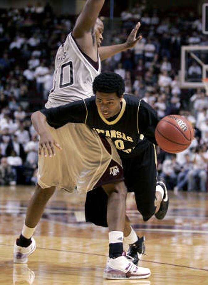 Joseph Jones (top) and A&M held Pine Bluff to 21 percent shooting on Sunday. Photo: Paul Zoeller, AP