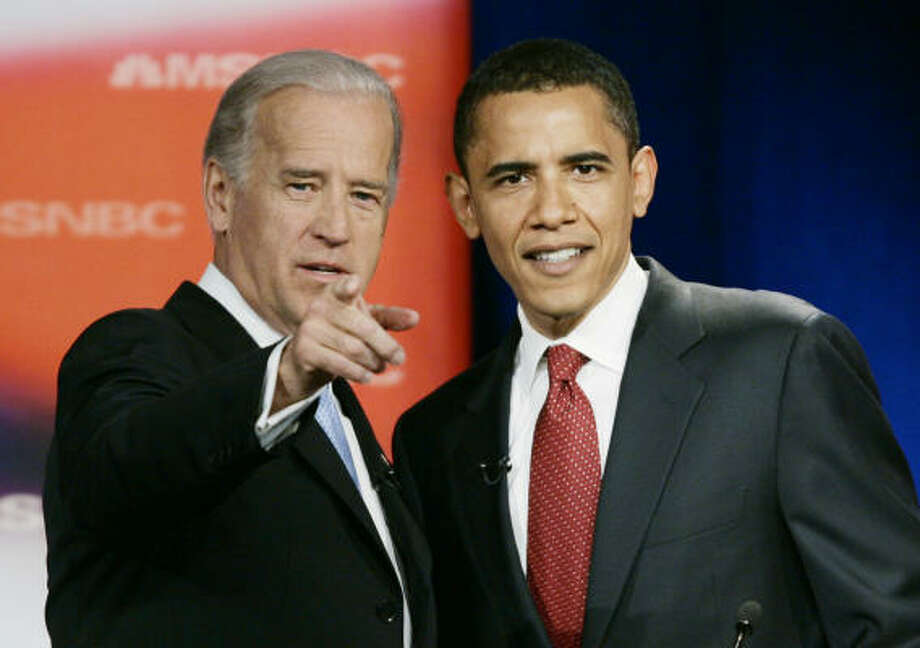 Sen. Joe Biden, D-Del., left, talks with Sen. Barack Obama, D-Ill., prior to the start of the first Democratic presidential primary debate of the 2008 election in Orangeburg, SC., on April 26, 2007, more than a year before they became running mates. Photo: J. Scott Applewhite, AP