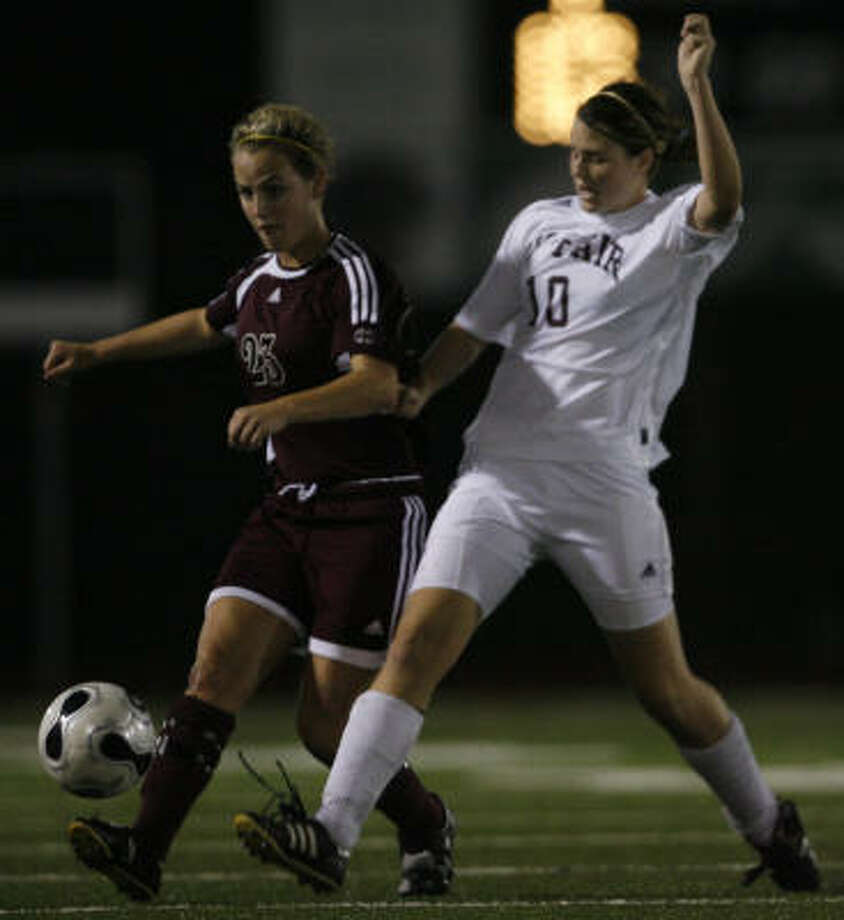Cy-Fair's Isla Cameron and Cinco Ranch's Jaimie Leake matched each other step for step, as did there teams, which tied 1-1. Photo: Aaron M. Sprecher, For The Chronicle
