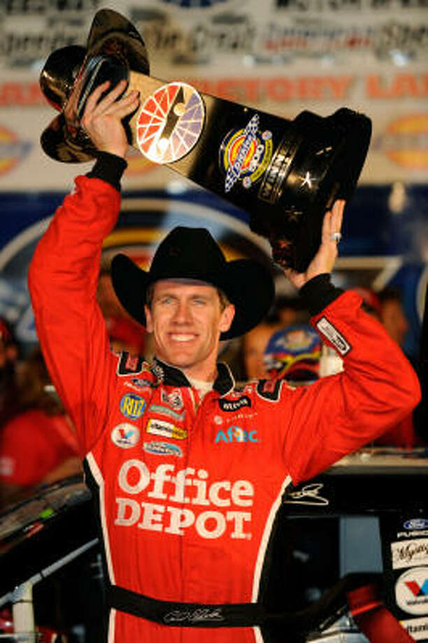 Carl Edwards, driver of the #99 Office Depot Ford, celebrates winning the NASCAR Sprint Cup Series Dickies 500 at Texas Motor Speedway. Photo: Rusty Jarrett, Getty Images For NASCAR