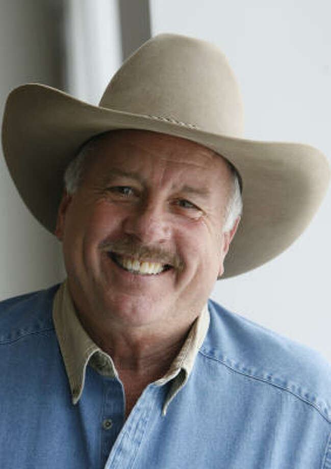 Volunteer Ed McMahon is a lifetime vice president for the Houston Livestock Show adn Rodeo. Photo: Kevin Fujii, Chronicle
