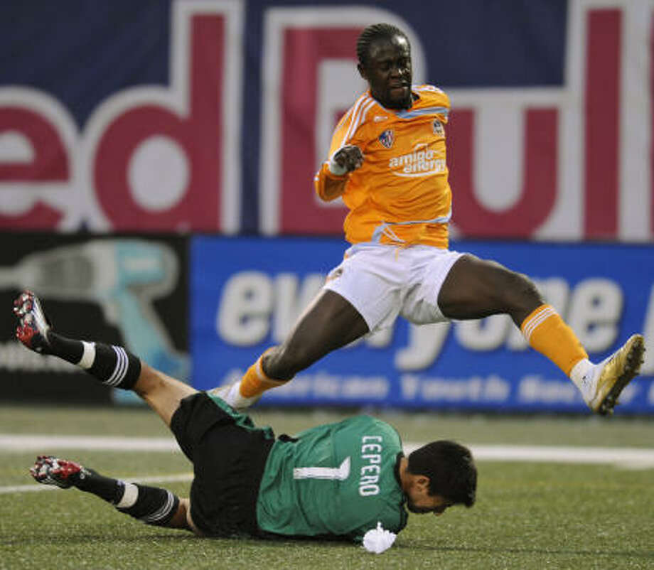 Kei Kamara is halted by Red Bulls keeper Danny Cepero at Giants Stadium. The teams tied in Saturday's first leg of a two-game playoff series. Photo: Bill Kostroun, AP