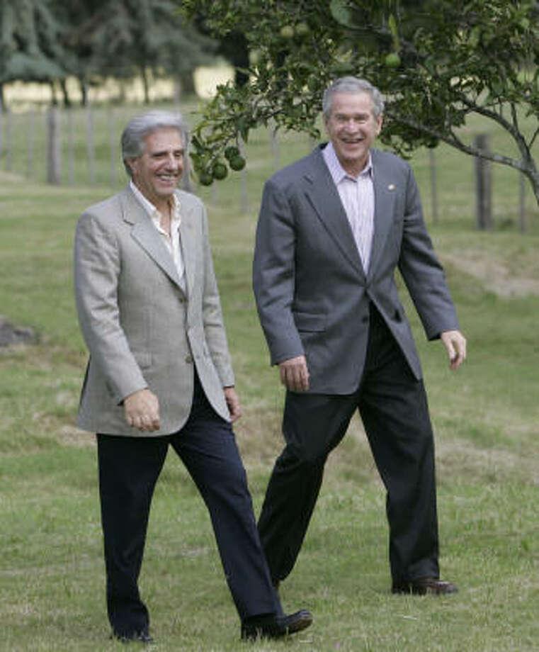 President Bush, right, walks with Uruguay President Tabare Vazquez March 10 in Anchorena Park, Uruguay. Photo: PABLO MARTINEZ MONSIVAIS, AP