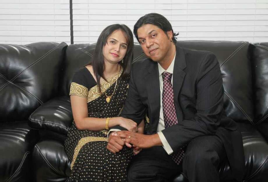 (For the Chronicle/Gary Fountain, July 16,  2011) Seema Arangaly, left, and Vivek Gopal on their living room sofa for a Sunday Star Love Story feature. They were married in a two-day traditional ceremony in India that included numerous sacred rituals. Photo: Gary Fountain, Freelance / Copyright 2011 Gary Fountain Telephone:  281-531-0260