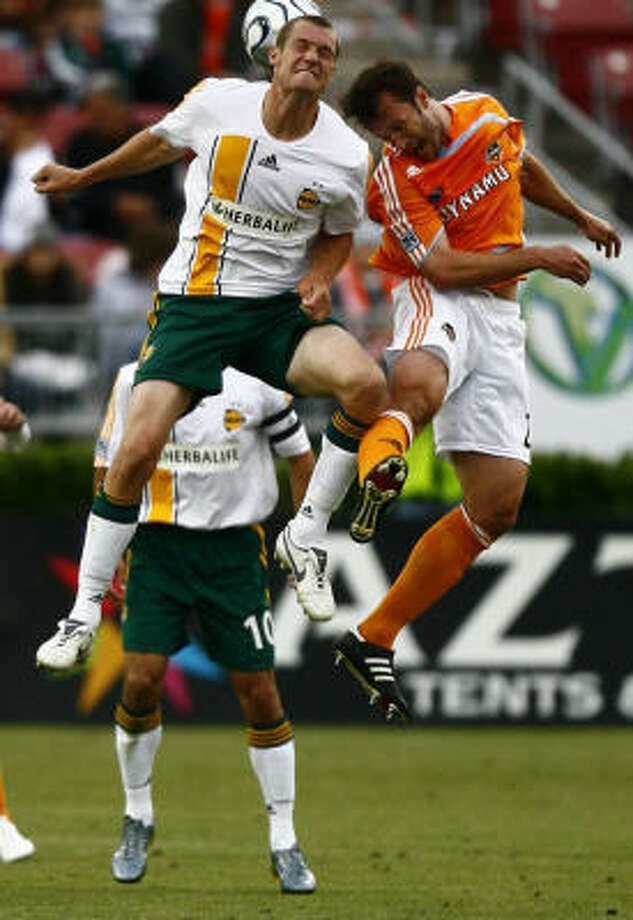 Eddie Robinson, right, says the Dynamo are having trouble finishing opponents off. Photo: Steve Ueckert, Chronicle