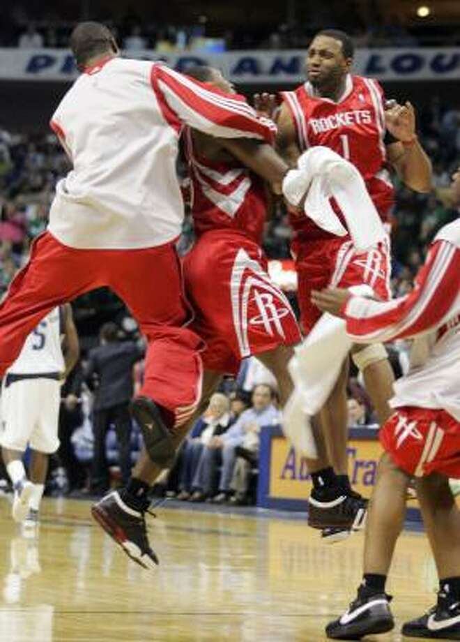 Rockets players celebrate a 3-point shot by Ron Artest late in the fourth quarter. Miss any of the action? Get the statistics here. Photo: Donna McWilliam, AP