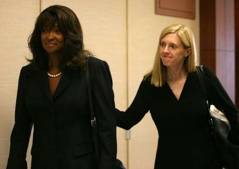 Former Texas Southern University President Priscilla Slade, left, walks with one of her attorneys, Jennifer Carroll, after a change of venue hearing at the Harris County Criminal courthouse on Monday. Photo: Sharon Steinmann, Chronicle